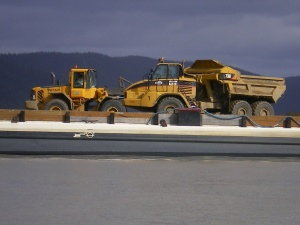 Heavy equipment on the barge; unloading gravel (lots)